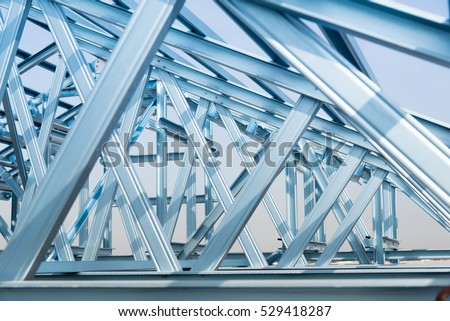 Structure of steel roof frame for building construction on sky background. #529418287