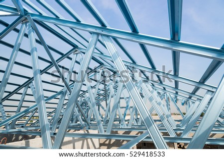 Structure of steel roof frame for building construction on sky background. #529418533