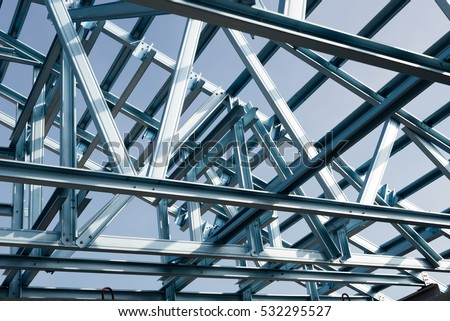 Structure of steel roof frame for building construction on sky background. #532295527