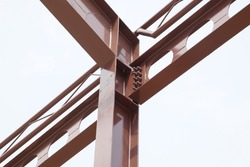 Structure steel beam, metal pillar installed for support preparing roof construction. Concept of structure steel, roofing, roof construction, girder, mounting, construction, skeleton.