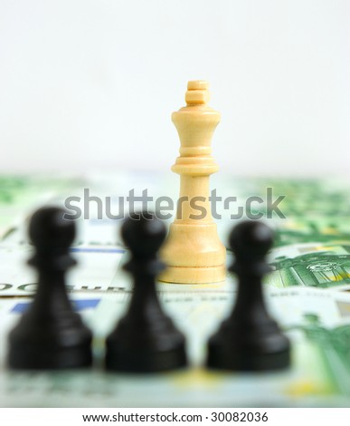 Struggle for authority among pawns and a queen on a background of money - stock photo