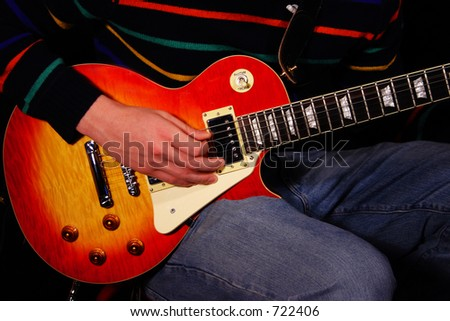strumming a classic sunburst pattern electric guitar stock photo 722406 shutterstock. Black Bedroom Furniture Sets. Home Design Ideas