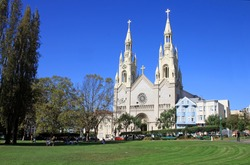 Sts. Peter and Paul Church in San Frascisco, USA, with people relaxing on the park