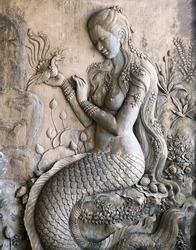 Stucco female mermaid figure is a beautiful work of art