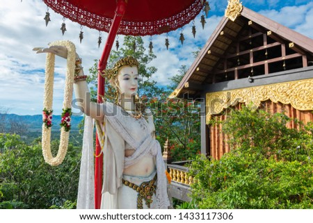 Stucco goddess,Stucco goddess in Wat Doi Pa Jhana is a Thai temple at Lampang province,Thailand,There is beauty in contemporary art is popular with many people,active lifestyle temple thailand concept #1433117306