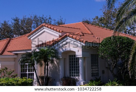 stucco home with tile roof