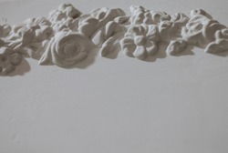 Stucco molding on a white wall. Interior decor of the Soviet time.