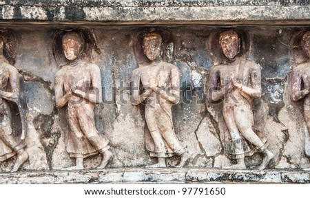 Stucco of worship people ,Wat Mahathat, Sukhothai Historical Park. Wat Mahathat is the most important and impressive temple compound in Sukhothai Historical Park.