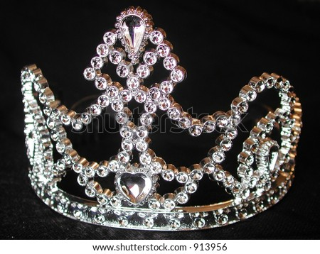 studded tiara on black background
