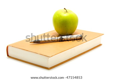 Student accessory with book, pen and apple over white background