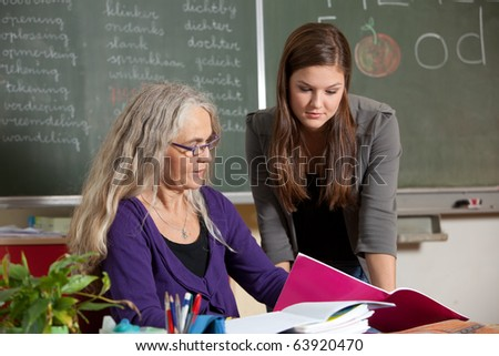 Student and teacher going through the homework that got handed in