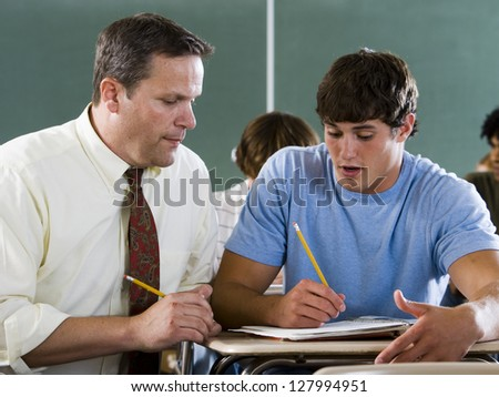 Student and teacher in a classroom.