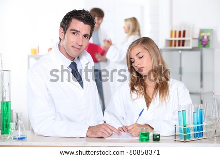 Student and teacher in chemistry class