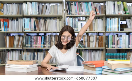 Student asian girl study with glasses finish hard reading book homework and happy learning feeling relax in classroom lesson education library knowledge center college high school university.