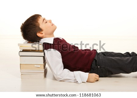 Student boy sleeping with head on stack of books  home