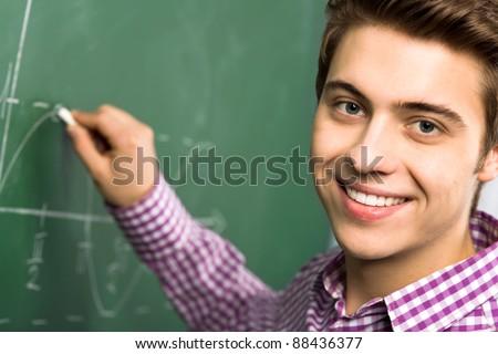 Student Doing Math on Chalkboard