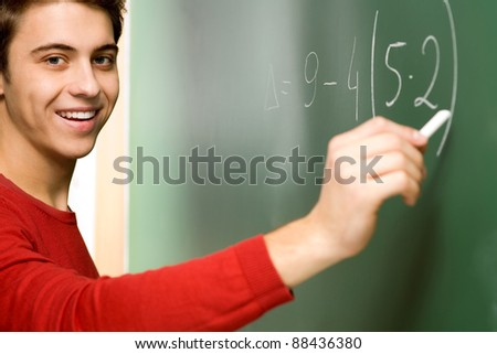 Student Doing Math on Chalkboard