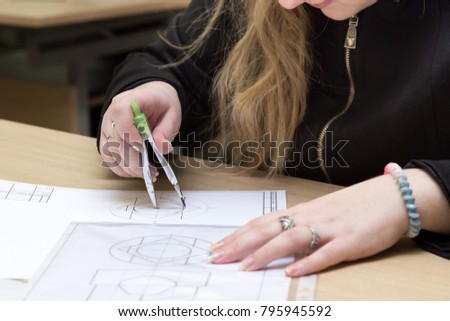 student draws drawing in engineering graphics class #795945592