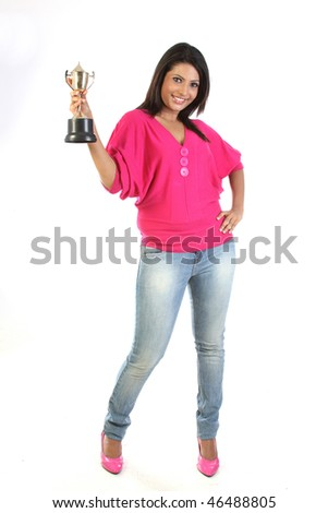 student girl holding the winning gold trophy
