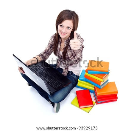Student girl learning with laptop and books, thumbs up - stock photo