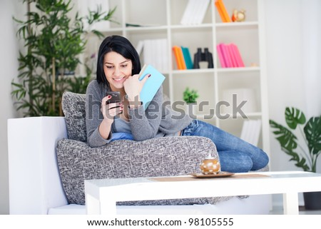 Student girl stopping learning and using phone