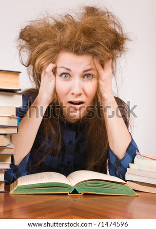 Student girl with books shows panic expression