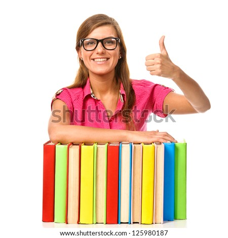 Student girl with pile book showing thumb up. Isolated