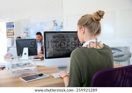 Student girl working on desktop computer