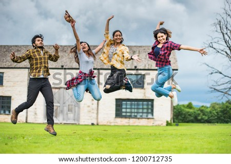 Student group Summer school excited;They are jumping, education, school and people concept - group of students in background at each other at school; Asia studen study.