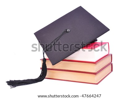 Student hat on books, on white with clipping path