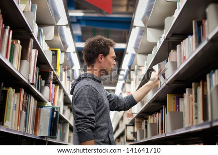 student in book shop or library