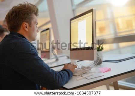 Student in class working on desktop computer