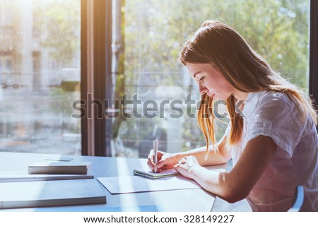 student in classroom during exam