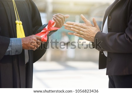 Student is accomplish the university degree and get certificate to certify education.Dad mom or college is clap hand to congratulations.Copy space is locate center using for announcement quote