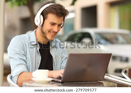 Student learning or entrepreneur working with a laptop in a bar terrace stock photo