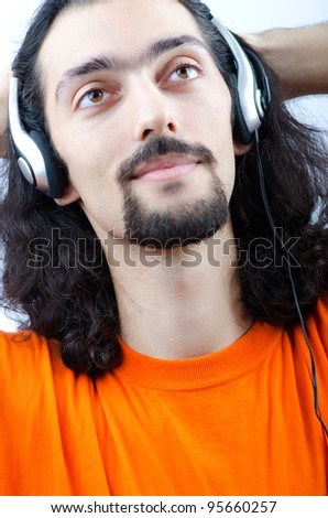 Student listening music isolated on white