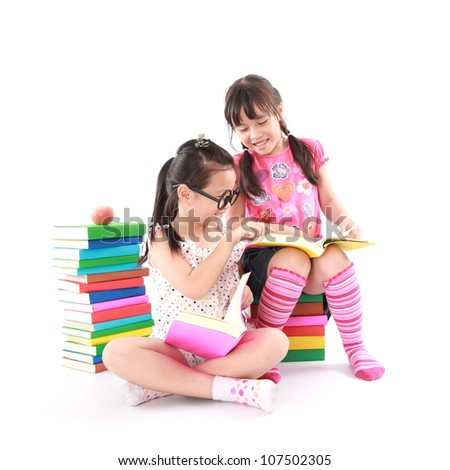 student little asian girl reading the book