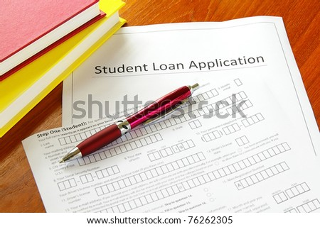 student loan application with books and pen