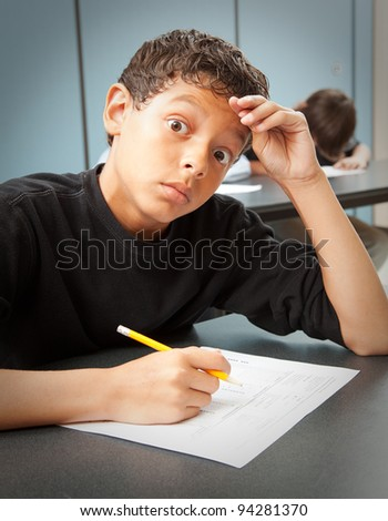 Student looks worried by a surprise quiz in class.