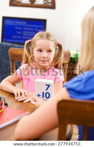 Student: Mother Helping Child Learn Math With Flash Cards