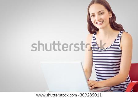 Student on laptop against grey vignette
