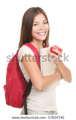 Student on white. Female mixed asian / caucasian college student isolated on white background holding a red apple.