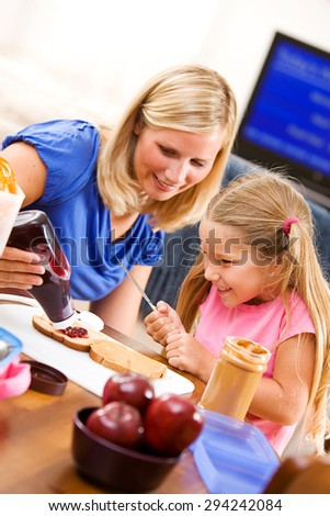 Student: Parent Helps Girl With Jelly On Sandwich Stock Photo ...