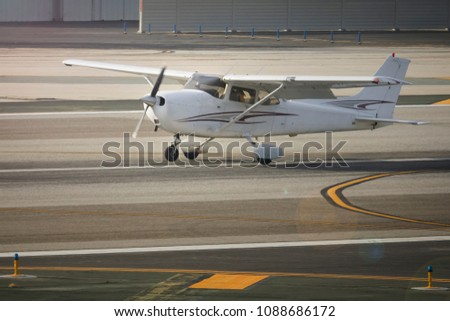 Student Pilot Is Practicing Landings In A Fixed Wing Cessna 172 At Santa Monica Airport, California