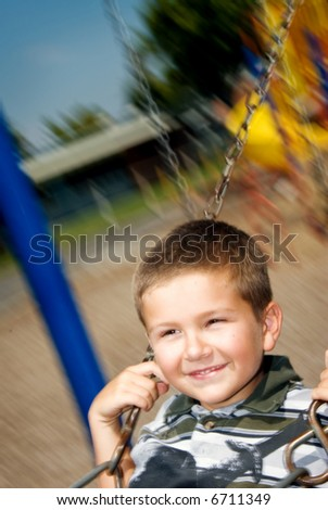 Student plays on a swingset during recess at school