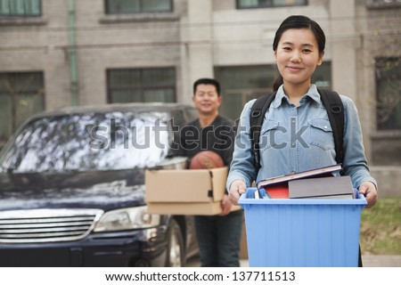 Student portrait in front of dormitory at college