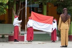 Student raising Indonesian flag in school