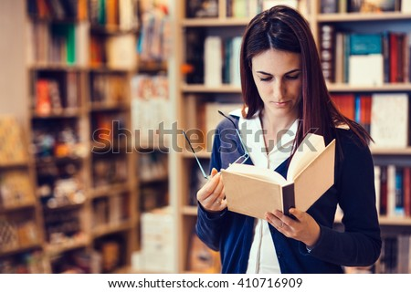Student reading a book/Reading a book #410716909