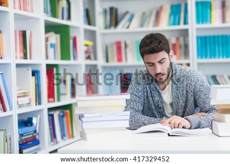 student reading book in library Study lessons for  exam.