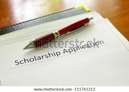 student scholarship application form on a desk - stock photo